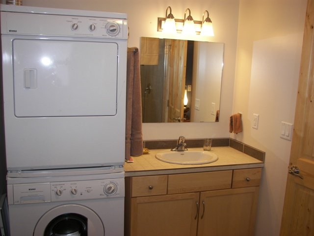 Washer and dryer in bathroom of cottage